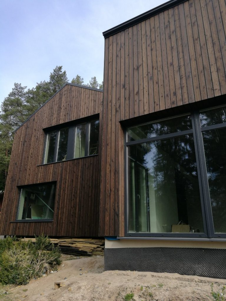 two house projects with Thermowood siding